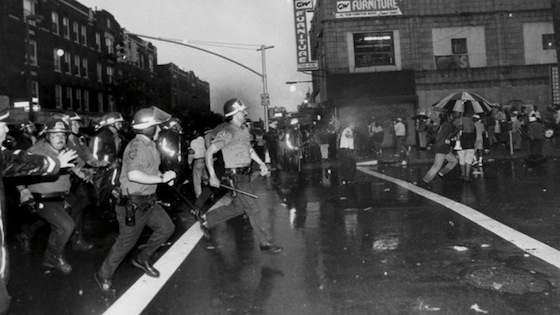 <i>Police try to diffuse a crowd during the 1991 Crown Heights Riot</i>. Photograph by Angel Franco. Cuny.edu