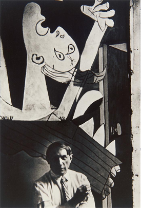 Chim, <i>Pablo Picasso in front of <i>Guernica</i> in his studio, Paris</i> (1937). In 1948, Sartre asked rhetorically, Does anyone think that it won over a single heart to the Spanish cause?
