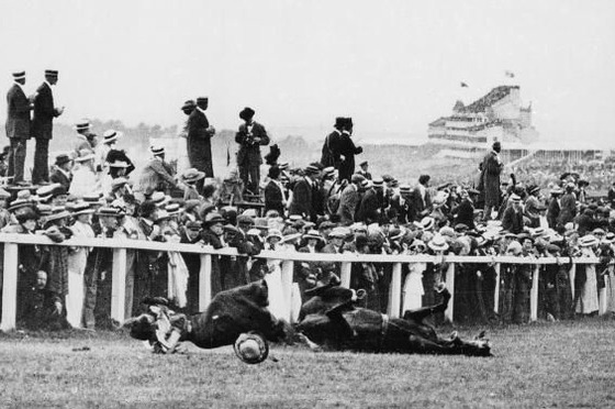 <i>Emily Davison is struck by the king's horse, Anmer, and knocked unconscious. She died four days later from a fractured skull</i> (1913). Photograph by Arthur Barrett / Wikimedia Commons