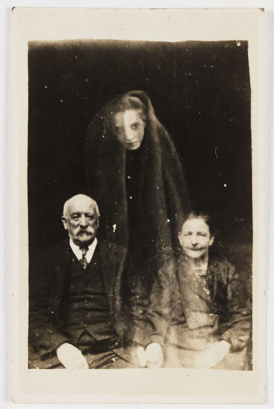 <i>Elderly couple with young female spirit</i>. Photograph by William Hope / Flickr