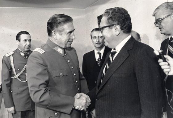 <i>Pinochet-Kissinger reunion, 1976</i>. Photograph courtesy of Chiles Archivo General Histórico del Ministerio de Relaciones Exteriores / Wikimedia Commons