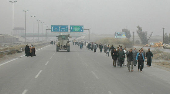 <i>Residents of the Al Monsour district of Baghdad walk to the polls during the first free Iraqi election on Jan. 30, 2005</i>. Photograph by US Department of Defense / Wikimedia