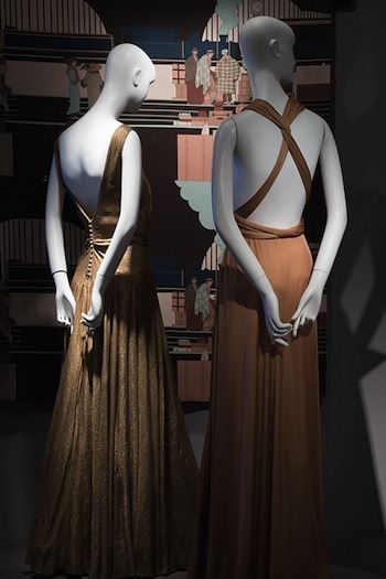 Farquharson & Wheelock, <i>Evening Dress</i> (USA, 1938). Gold lamé. The Museum at FIT, 82.151.113. Gift of Mrs. Jefferson Patterson; Halston, <i>Halter Dress</i> (USA, 197273). Copper silk jersey. The Museum at FIT, 76.118.3. Gift of Lauren Bacall