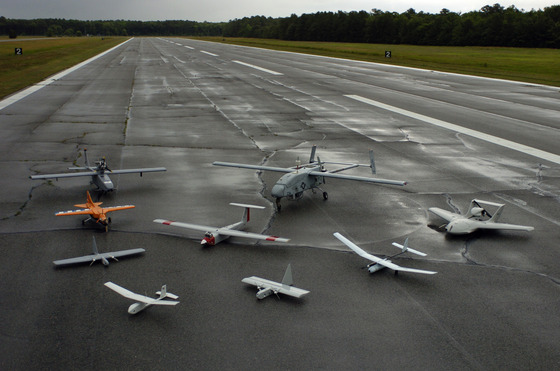 <i>Group photo of aerial demonstrators at the 2005 Naval Unmanned Aerial Vehicle Air Demo</i> (2005). Wikimedia Commons / US Navy photograph by Photographers Mate 2nd Class Daniel J. McLain