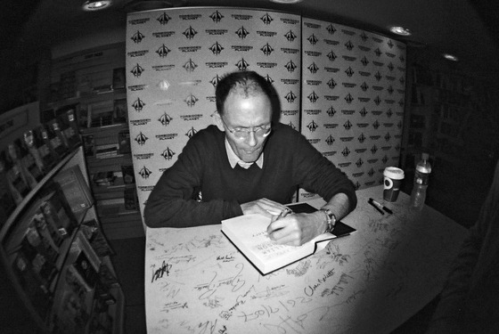 <i>Gibson signs a copy of </i>Zero History (2010). Photograph by Nikki Tysoe / Flickr