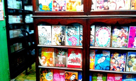 <i>An assortment of scripts used in Jatra, the folk theatre of Bengal, in a shop in Chipur, the Jatra neighborhood. Some of the titles, roughly translated: </i>Salary Retains Mother<i>; </i>Groveling Retains Wife<i>; </i>The Shipwreck of Love<i>; </i>Wish to Sell the Nation, Need a Pimp<i>. </i>Photograph by Rajat Chaudhuri