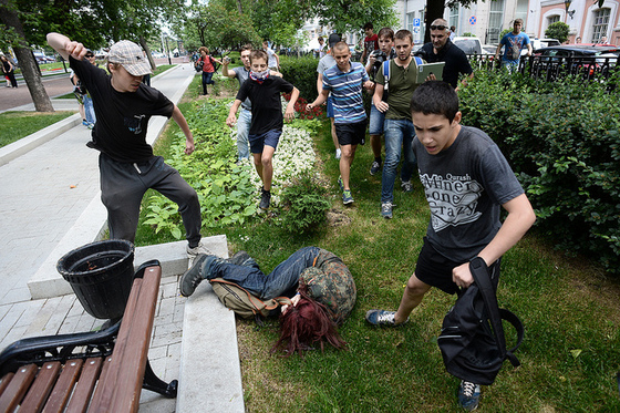 <i>LBGT activists attacked during Day of Kisses rally against a homophobic bill in Moscow</i>. Photograph by Roma Yandolin / Flickr