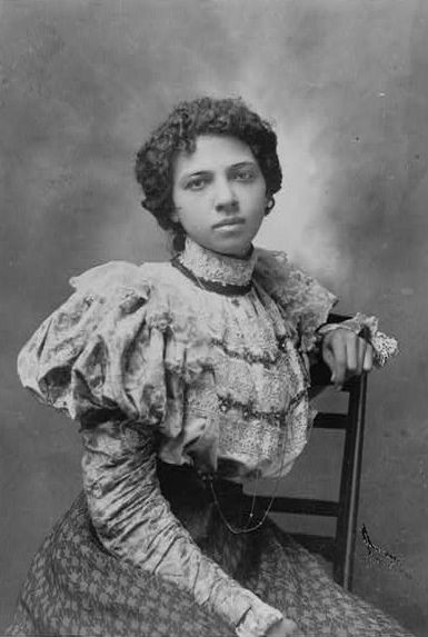 <i>African American woman, three-quarter length portrait, seated with left arm over back of chair, facing front.</i> Photograph courtesy of Library of Congress Prints and Photographs.