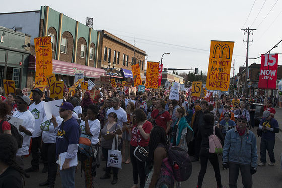 <i>A Strike and a protest march for a $15 minimum wage in Dinkytown, Minneapolis</i>. Photograph by Fibonacci Blue / Wikimedia
