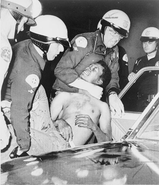 <i>One of nearly 4,000 arrests during the Watts uprising, 1965</i>. Photograph courtesy of <i>New York World-Telegram</i>/Library of Congress
