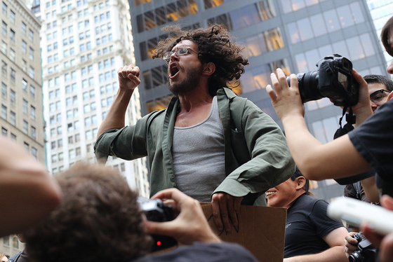 <i>Fist pump at Occupy Wall Street</i>. Photograph by Timothy Krause / Flickr