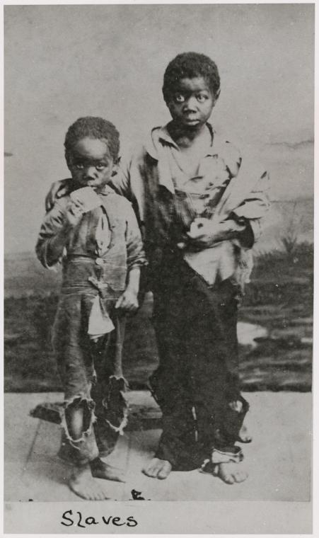 <i>Two young slave boys</i>. Photograph courtesy of NYPL Schomburg Center