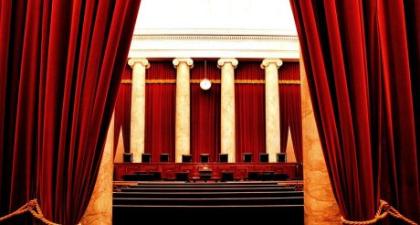 The nine chairs of the Justices lined up in the Court Chamber